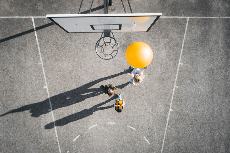 High angle view of man playing with ball on street