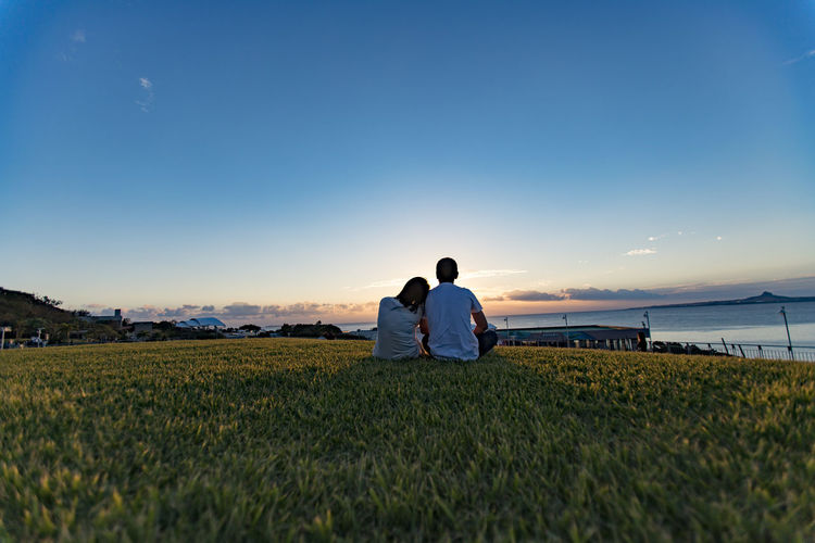 EyeEm Best Shots EyeEm Nature Lover Okinawa Churaumi Aquarium Sunset_collection Beauty In Nature Blue Clear Sky Grass Nature Outdoors Rear View Sitting Sky Sunset Togetherness Tranquil Scene Two People Be. Ready.