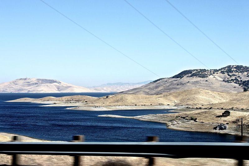 View of san luis reservoir against clear sky