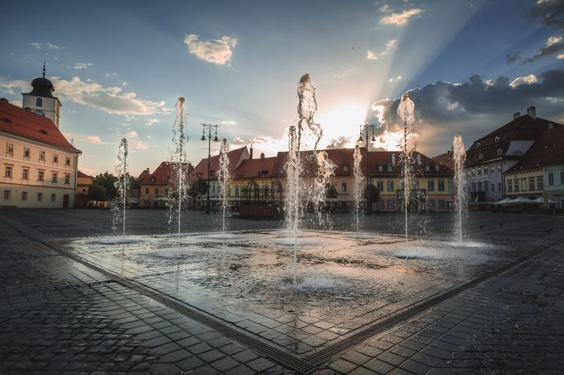Old town Sibiu Romania Sibiu, Romania Cityscape History Travel Destinations Square Sky Architecture Cloud - Sky Built Structure Water Building Exterior City Splashing Building Fountain Street Spraying Outdoors Wet