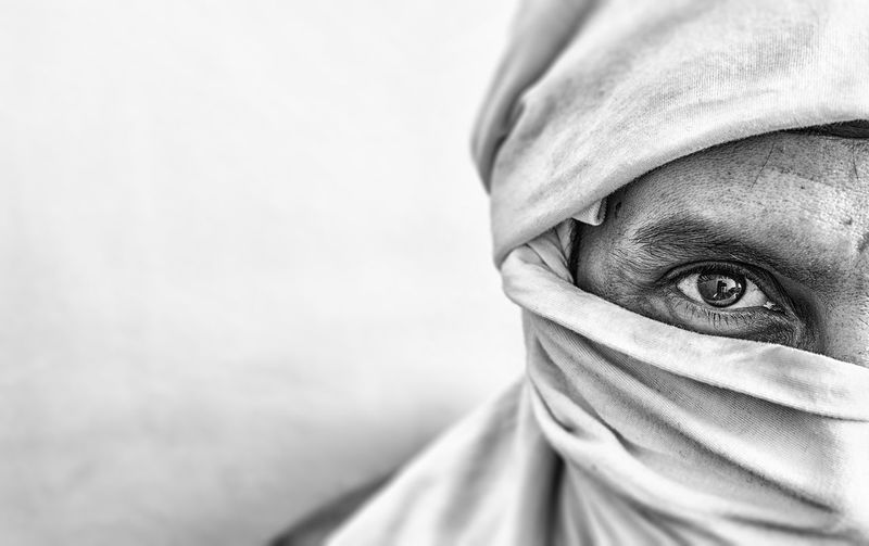 Portrait Of Man Face Covered With Fabric