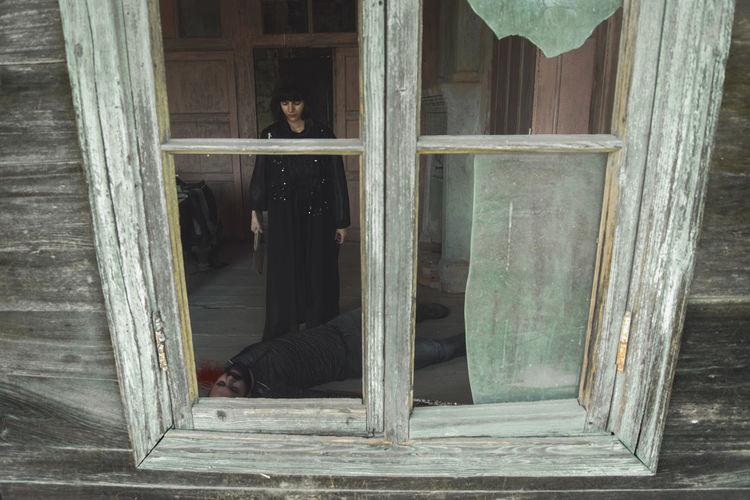 Woman Murdered Man Seen Through Broken Window