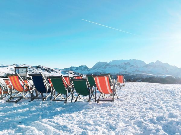 Scenics Snow Sun Sunchair Sun Chairs On Rocks Blue Sky Travel Winter Wintervacation Relaxing Alpine Dolomites, Italy Copy Space Cold Temperature Mountain Mountain View Vacation Time Chairs Beauty In Nature Nature No People Day Outdoors Landscape Sky Shades Of Winter