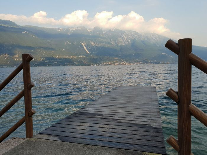 Italia Beauty In Nature Cloud - Sky Day Idyllic Italy Italy❤️ Mountain Nature No People Non-urban Scene Outdoors Pier Railing Scenics - Nature Sea Sky Tranquil Scene Tranquility Water Wood - Material