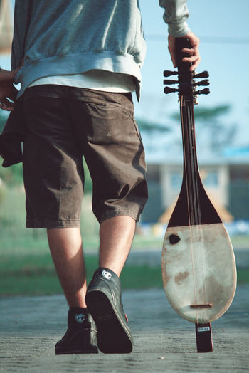 Music This Is Masculinity Arts Culture And Entertainment Close-up Day Gambus Holding Leisure Activity Lifestyles Low Section Melayu Men Music Musical Musical Instrument Musician One Person Outdoors People Playing Real People Riau Riau Indonesia Skill  Standing Stories From The City