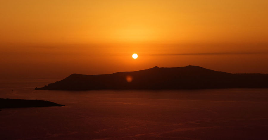 Beautiful Santorini 2 y.a. Beautiful Holidays Beauty In Nature Day Greece Landscape Mountain Nature No People Orange Color Outdoors Santorini Scenics Sea Silhouette Sky Sun Sunset Tranquil Scene Tranquility Vacation Water