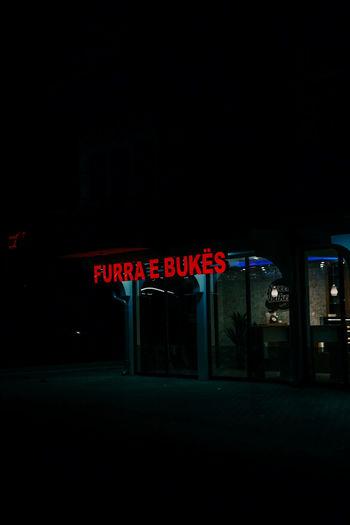Illuminated information sign at night