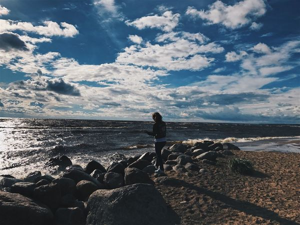 Sea Water Beach Standing One Person Nature Rock - Object Real People Beauty In Nature Sky Leisure Activity Tranquil Scene Horizon Over Water Tranquility Full Length Rear View Day Scenics Women Vacations