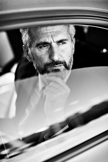 Thoughtful businessman sitting in car