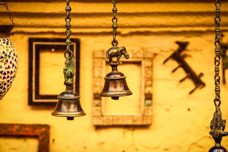 Close-Up Of Bells Hanging Hanging Outdoors