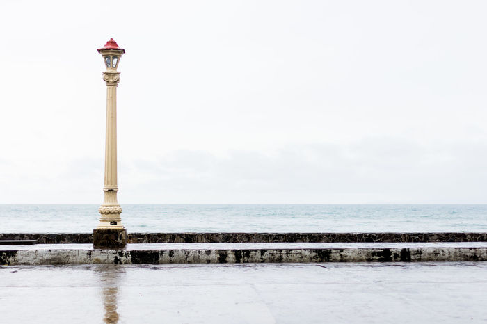 Lamp post at the seaside. Basic Beach Beach Front Beauty In Nature Cloud - Sky Cold Temperature Curb Day Empty Exposure Horizon Over Water Minimal Nature No People Outdoors Promenade Rainy Days Scenics Sea Sea Side Simple Sky Tranquility Water Weather