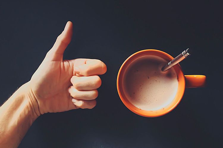 Mug Of Coffee And Hand Giving Thumbs Up