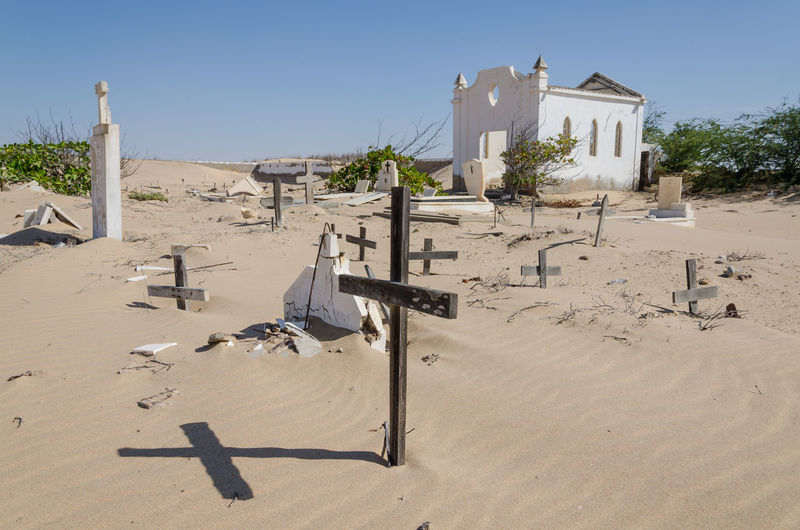 View of abandoned cemetery in desert against clear sky