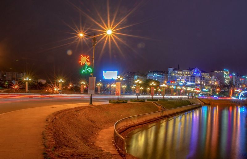 Sắc màu của đêm Photoo Illuminated Architecture City Building Exterior Built Structure Building Street Water No People Lighting Equipment Reflection Nature Glowing Street Light Motion Office Building Exterior Transportation Long Exposure Sky Night