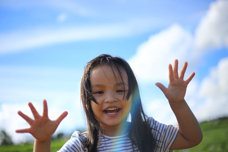 Asian  Asian Girl Blue Day Focus On Foreground Front View Innocence Leisure Activity Lifestyles Little Girl Person Sky