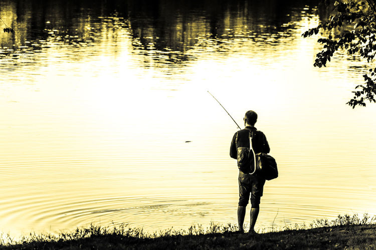 Extreme Light Fisherman, Fishing, Urban Look, Pond, Yellow Filter, Leisure Activity Nature One Person Outdoors Real People Silhouette Water Circle Yellowish Tint