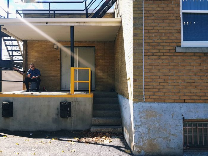 Man sitting outside building