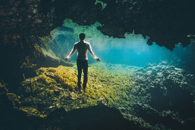 Water One Person Sea Real People Nature Full Length Leisure Activity Underwater Standing Rock Lifestyles Rear View Rock - Object Solid Beauty In Nature Day Outdoors Men UnderSea Shorts