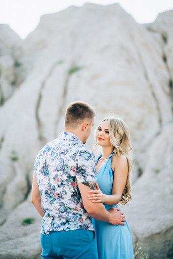 Happy couple standing on mountain