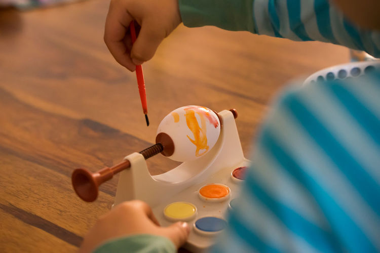 Art Art And Craft Boy Child Childhood Close-up Creativity Easter Eggs Easter Ready Hand Hands Having Fun Holding Indoors  Paint Painting Part Of Person Preparation  Selective Focus