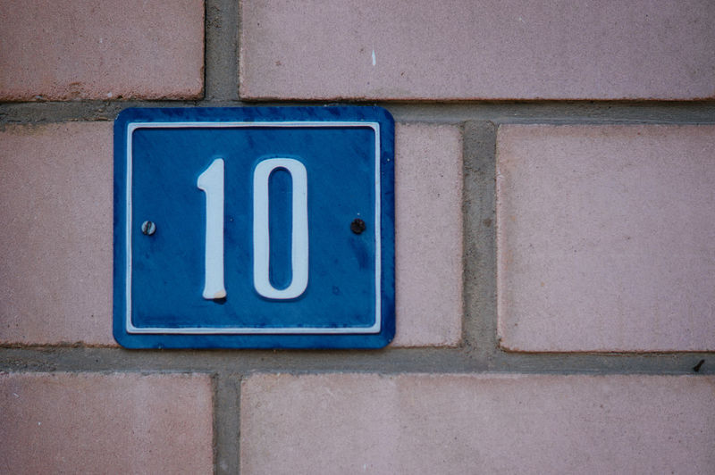 House number sign on brick wall