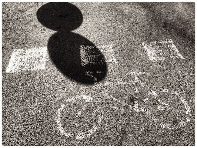 Focus On Shadow Sunlight Shadow Outdoors Day Close-up No People Lifestyles Black And White Pavement Signage Bicycle