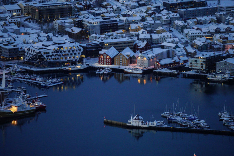 High Angle View Of Boats Moored At Harbor In City