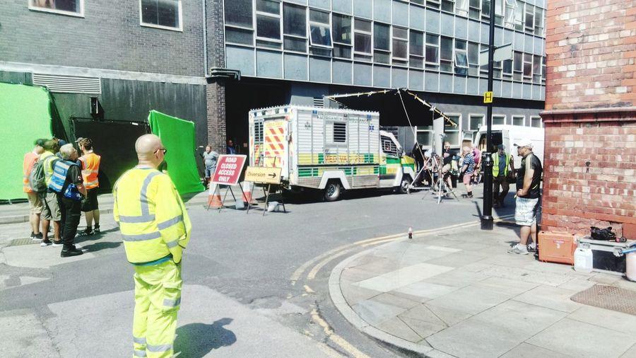 filming a scene outside old Granada studios. Manchester UK Film Scenery Shots Film Scene Movıe Movie Set Seanbean Ambulance Paramedic In Action City Vehicle Street Street Scene City Street