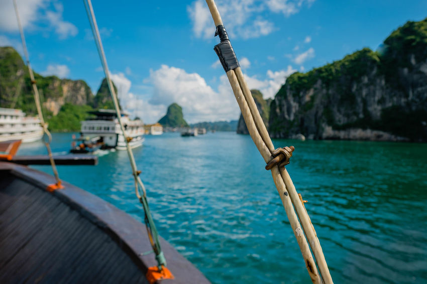 Floating along in Halong Bay Beauty In Nature Built Structure Close-up Cloud - Sky Day Focus On Foreground Mode Of Transportation Nature Nautical Vessel No People Outdoors Sailboat Sailing Sea Sky Transportation Travel Water Wood - Material