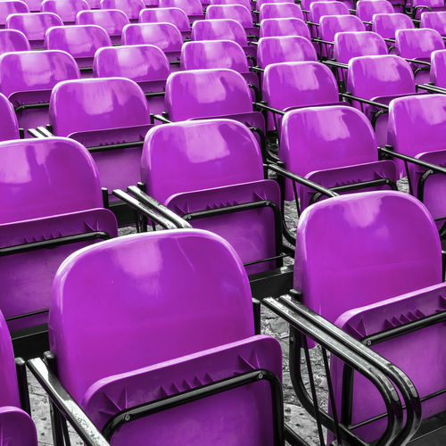 Empty plastic violet chairs In outdoor theater Violet Public Action Actors Art Background Chair Closed Color Comedy Empty Event LINE Nobody Objects Outdoors Pattern Plastic Row Seat Sitting Stage Stories Theater To Act Waiting