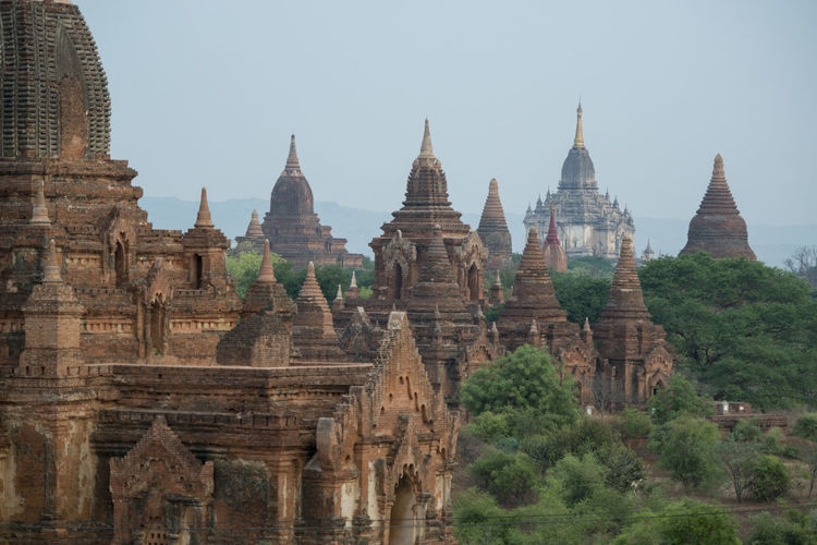Old ruins of temples against clear sky