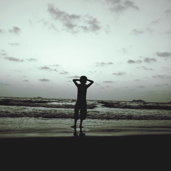 Beach One Person One Man Only Adult Only Men Standing People Men Human Body Part Adults Only Silhouette Sea Full Length Outdoors Cloud - Sky Water Vacations Nature Scenics Sky Beachtime Beach Holiday Relaxation Beachside Cameraneverstops Break The Mold Lost In The Landscape