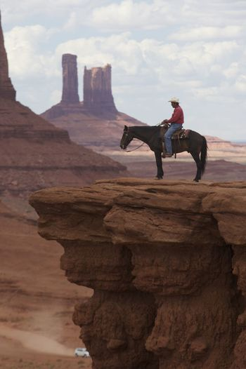 The Cowboy of Monument Valley Beautiful Boots Bridge Colors Cowboy Desert Horse Monument Valley Nature Roadtrip Stare Tourist USA
