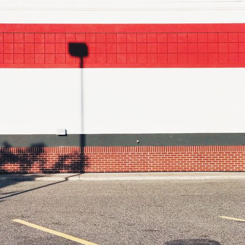Take Out. Red Built Structure No People Day Architecture Shadow Façade Bricks Wall Absence Wall - Building Feature City Road Street