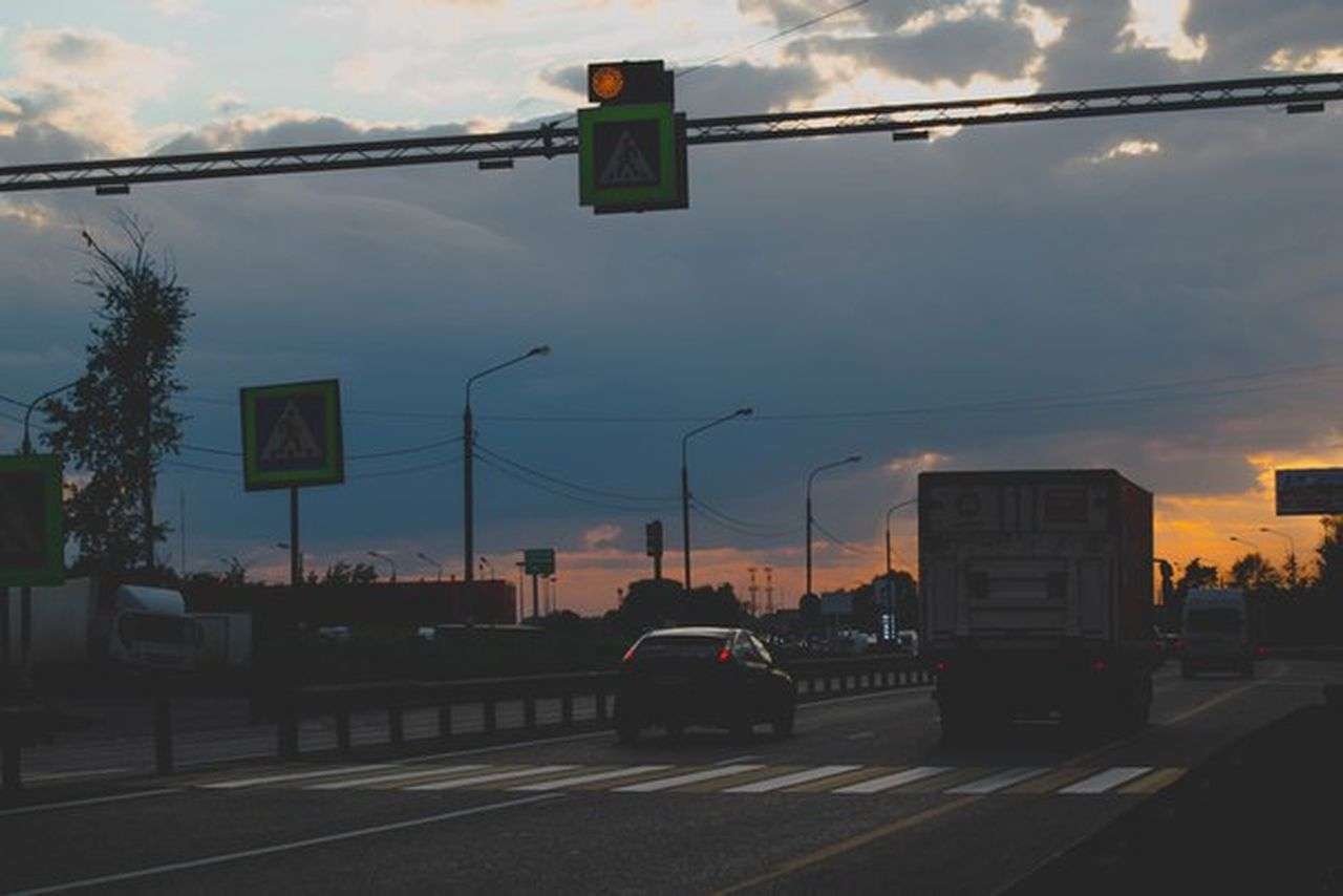 transportation, sunset, car, stoplight, sky, city, cable, road, illuminated, architecture, road sign, outdoors, no people, day
