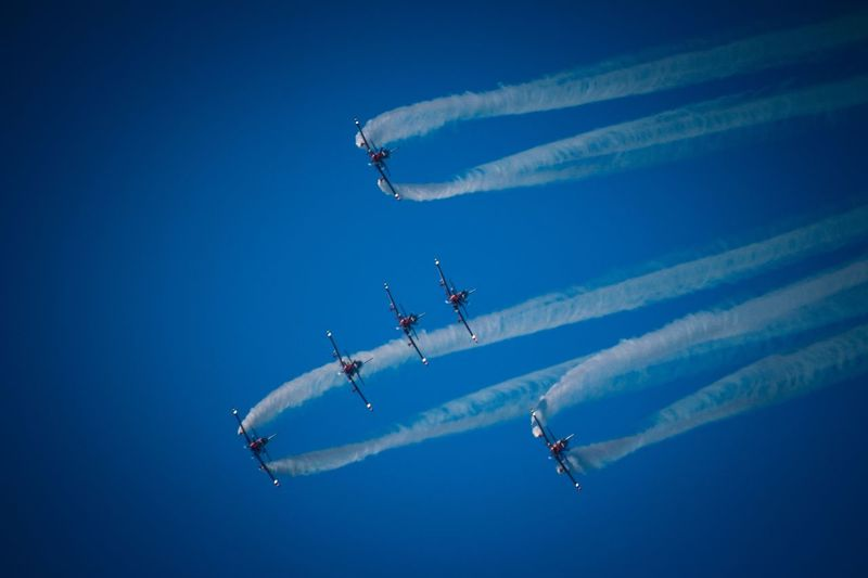 Airshow Vapor Trail Speed Smoke - Physical Structure Teamwork Performance Flying Fighter Plane Airplane Stunt Aerobatics Military Airplane Formation Flying Transportation Blue Air Vehicle Skill  Mid-air Motion Low Angle View