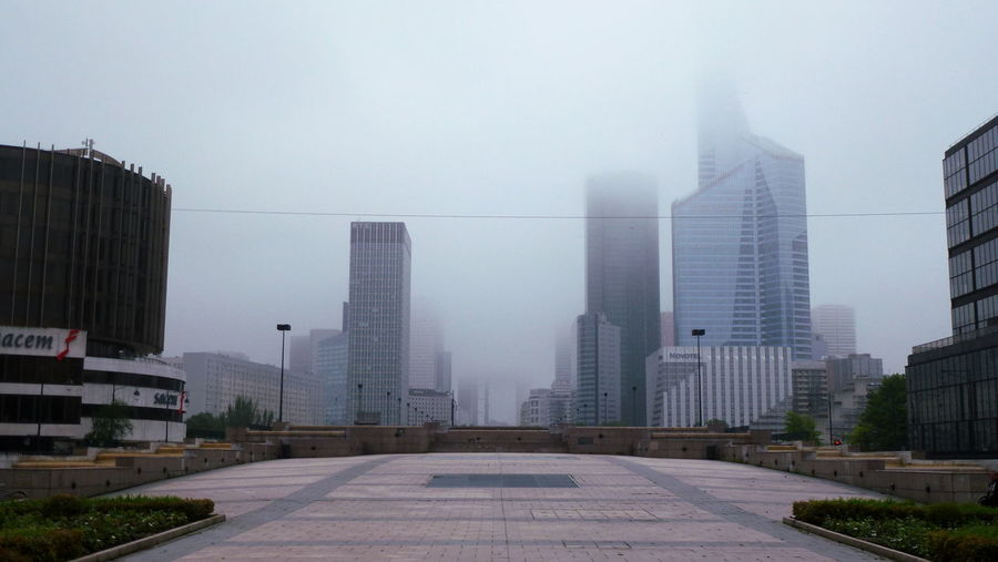 "If you look closely, you can just make out ""La Grande Arche de la Défense"". Architecture Building Building Exterior Built Structure Business District Capital Cities  City City Life Cityscape Foggy Foggy Day No People Office Building Overcast Skyscraper Tall - High Urban Skyline View"