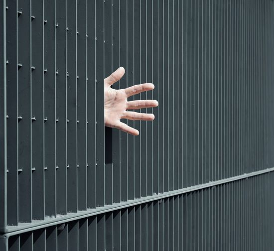 Fingers Architectural Feature Lines Pattern Bars Hand People Geometry Minimalism One Person Human Hand Palm Stop Gesture Security Bar Justice - Concept Confined Space #FREIHEITBERLIN Creative Space The Still Life Photographer - 2018 EyeEm Awards #urbanana: The Urban Playground Be Brave A New Beginning Capture Tomorrow Humanity Meets Technology