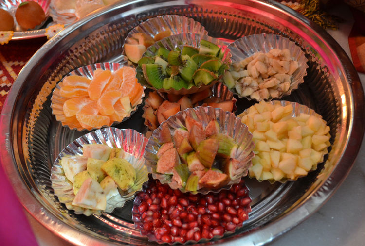 High angle view of various fruits in plates