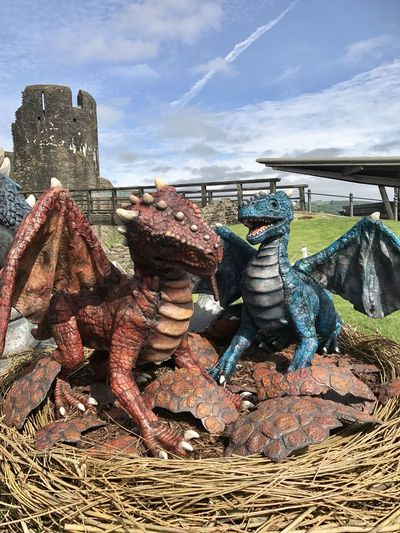 Caerphilly Castle, Baby Dragon Dragon Wales Wales UK Close-up Representation Basket Land Rusty No People Architecture Metal Outdoors Sculpture Stack Art And Craft Cloud - Sky Old Built Structure Day Damaged Field Sky Nature