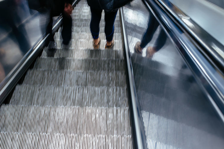 Low Section Of People Standing In Escalator