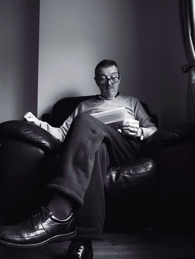 """""""Portrait of a Father"""" Indoors  Sitting Relaxation Close-up Home Interior Abundance Floor Side By Side Directly Above Arrangement Full Frame Friendship Front View Looking Occupation Fashion Home Hobbies Reading Portrait Man Older Man Glasses Letter The Portraitist - 2016 EyeEm Awards"""
