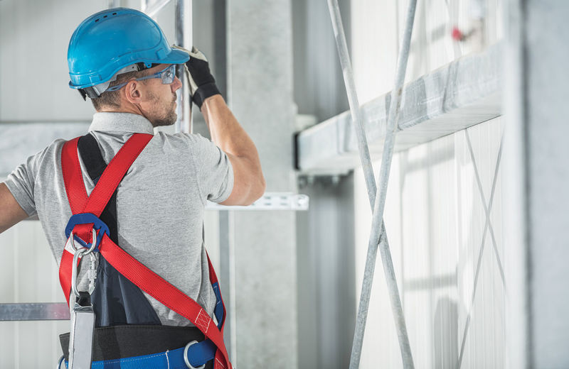 Low angle view of man working at site