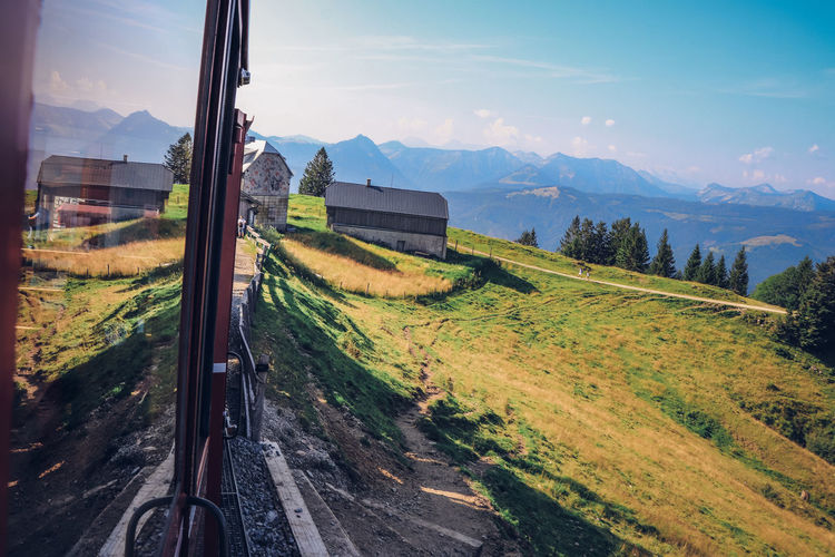 View from the moving historic train on the schafberg mountain to the surrounding countryside alps