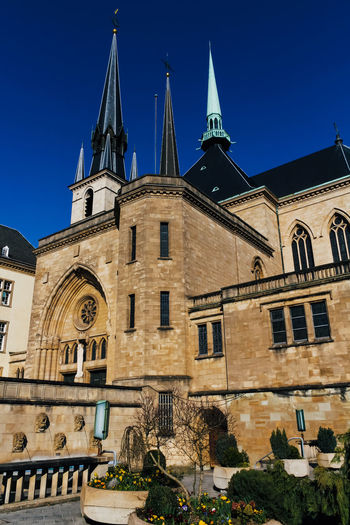 Building Exterior Architecture Built Structure Building Sky Belief Religion Low Angle View Place Of Worship Spirituality Nature Clear Sky History Blue The Past Travel Destinations No People Outdoors Spire  Clock Luxembourg Cathedral Tower Church Outside Church Architecture Catholic