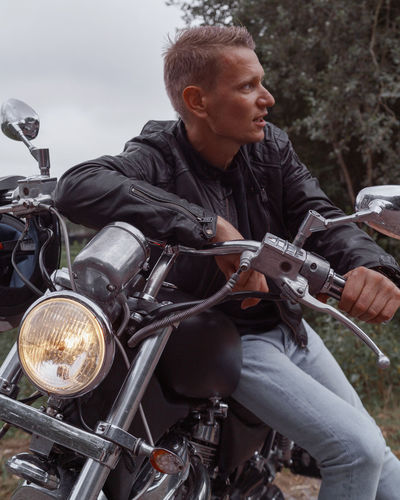Full length of young man riding motorcycle