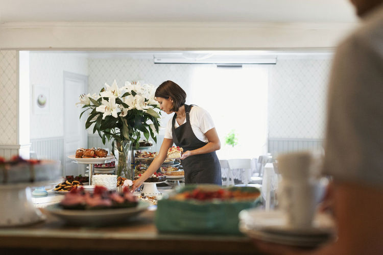 Woman preparing food on table at home