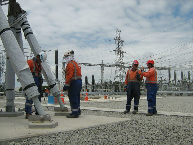 In the Switch Yard 220 KV Circuit Lines Construction Site Discussion Electricity Pylon Health And Safety Hi Viz Power Network Protection Clothing Teamwork