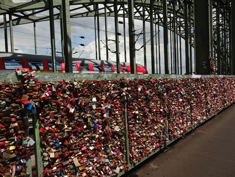 Abundance Large Group Of Objects Railing Day Padlock No People Love Lock Lock Bridge - Man Made Structure Outdoors Travel Destinations Architecture Sky Close-up Köln Railway Railway Bridge Eisenbahnbrücke Glücksbringer Schloss Rheinbrücke Colour Red Metal Metal Structure The Week On EyeEm