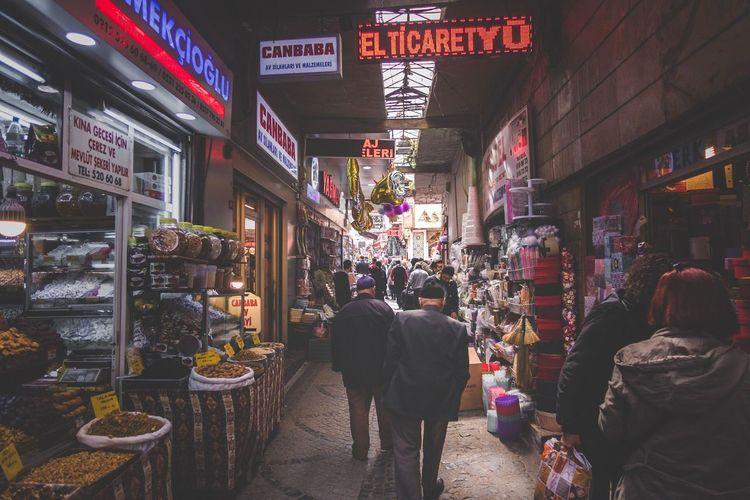 People At Illuminated Market At Night